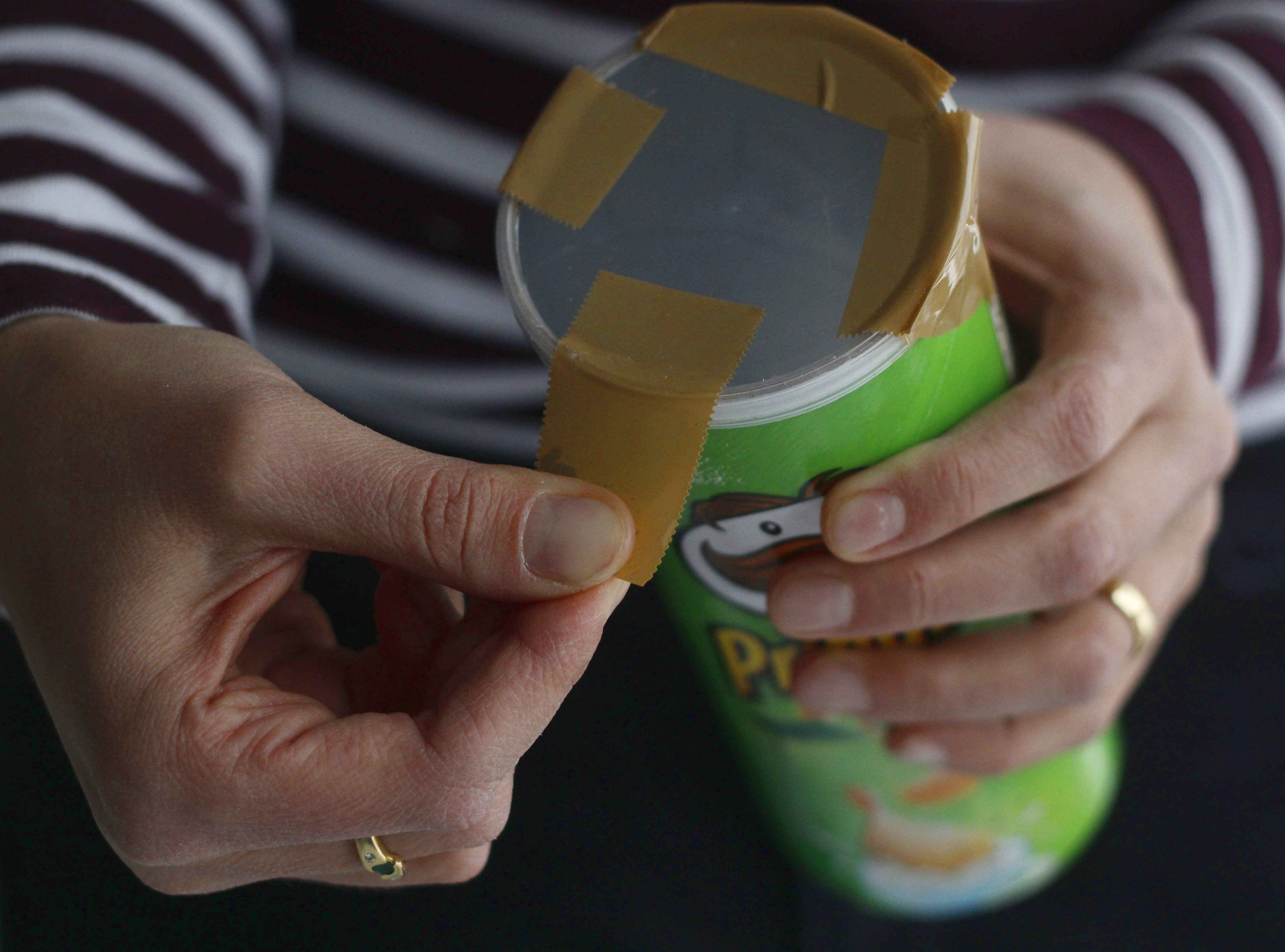 Firmly taping lid to the can to avoid soap batter seeping out.