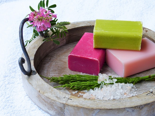 3 handmade soaps in a wooden bowl
