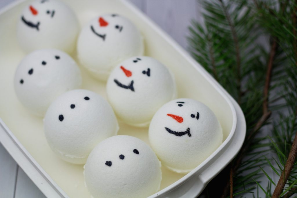 snowman bath bombs painted with faces and buttons