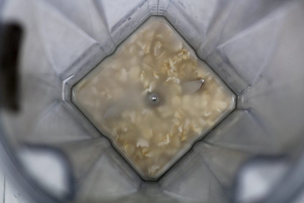 rolled oats and water in blender
