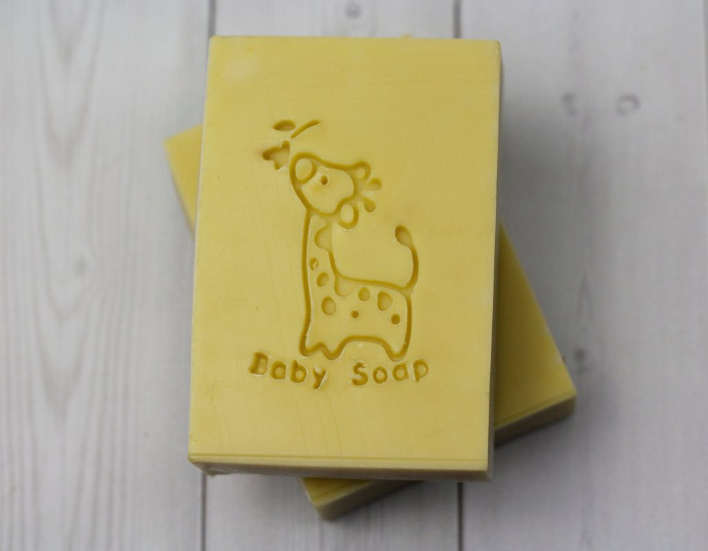 stack of soaps stamped with baby giraffe