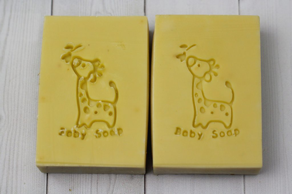 two stamped baby soaps