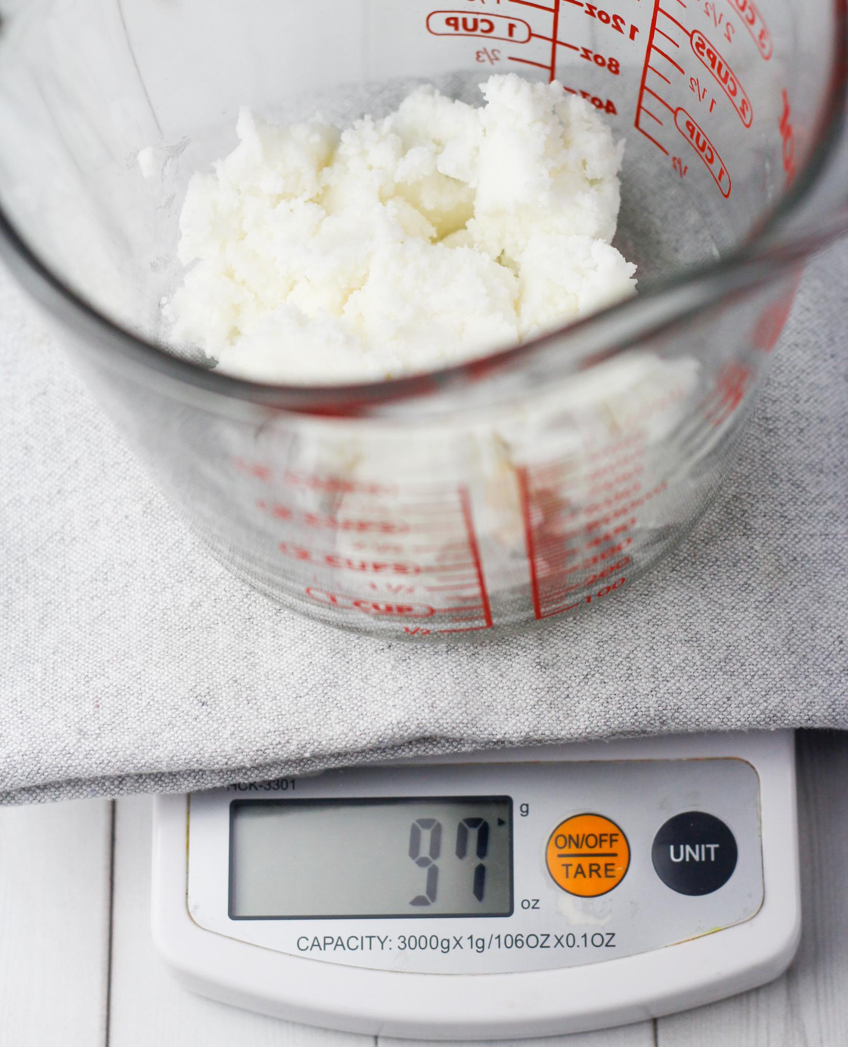 shea butter in measuring bowl